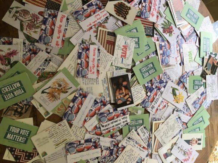 A pile of handwritten postcards