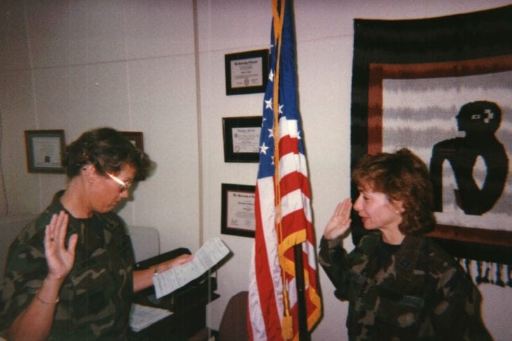 Tammy being sworn into the military