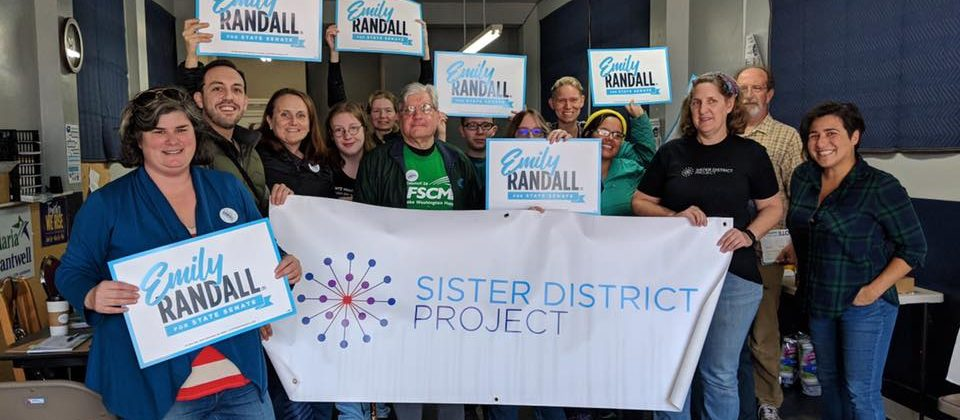 Sister District volunteers with Washington candidate Emily Randall