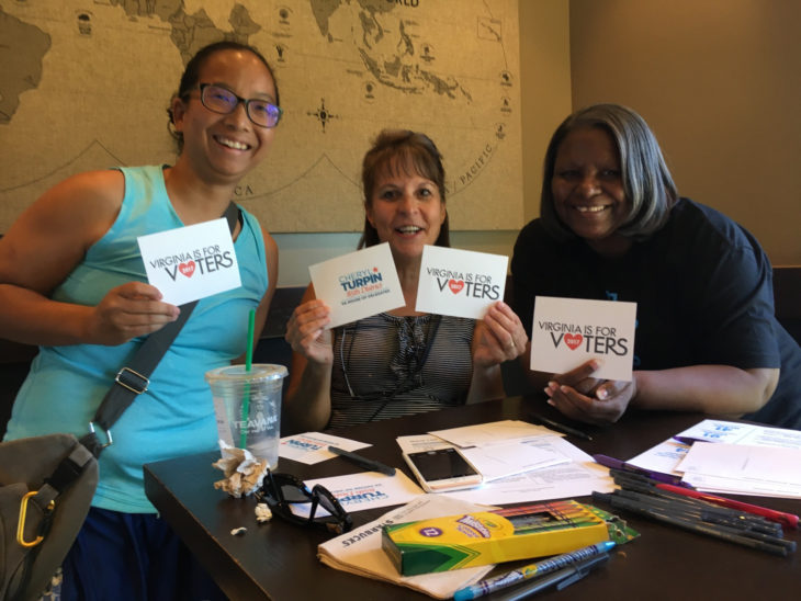 Sister District volunteers in California write postcards to voters